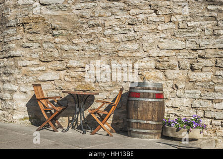 Table, chairs and a Wine barrel in a picturesque alley on the Cathedral Hill (Toompea), Tallinn, Estonia, Baltic - Stock Photo