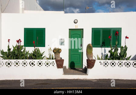 Typical white house with green doors and window shutters in  Lanzarote Canary Islands Spain - Stock Photo