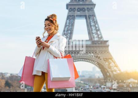Woman doing shopping in Paris - Stock Photo