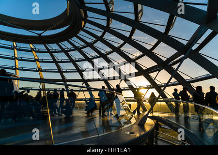 Interior of Reichstag dome with visitors in evening light, Reichstag, Bundestag, Berlin, Germany - Stock Photo