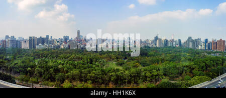 Aerial view of Daan Forest Park and Taipei cityscape around afternoon - Stock Photo