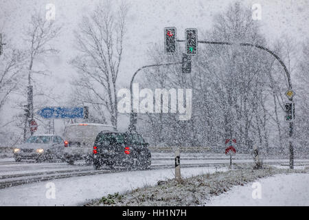 traffic in heavy snowfall car driving on a snow covered road surface stock photo royalty free. Black Bedroom Furniture Sets. Home Design Ideas