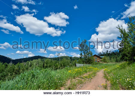 Trail leads to lodging in the Lutsen Mountains resort area, as seen on a beautiful spring day. - Stock Photo