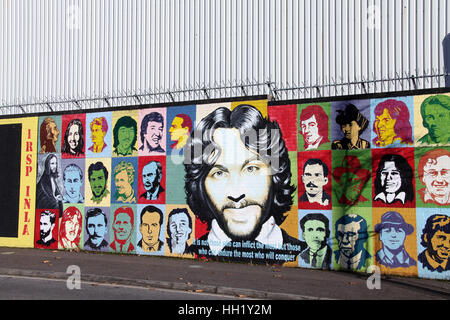 International Peace Wall on the Falls Road in Belfast - Stock Photo