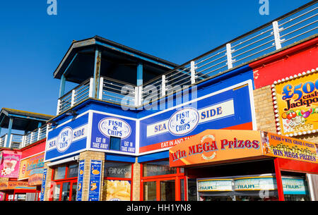 Seaside shop front logos at Clarence Esplanade, Southsea, Portsmouth, Hampshire, southern England: ice cream, fish - Stock Photo