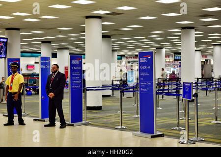 Inside Miami International Airport (MIA), British Airways check in counter - Stock Photo