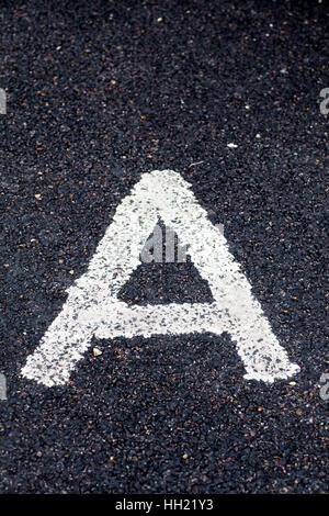Letter A painted on the road - Stock Photo