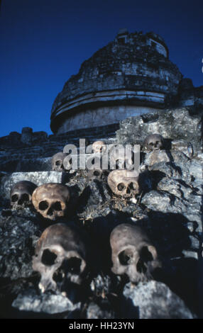 The Observatory at Chichen Itza, with a set of skulls that were found in the nearby cenote in 1967. - Stock Photo