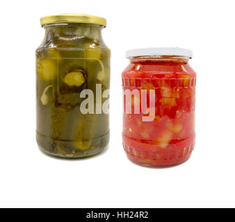 Pickled cucumbers and peppers in tomato sauce in jar - Stock Photo