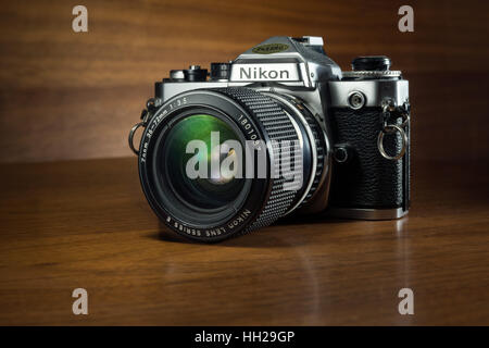 A classic, collectible Nikon FE 35mm SLR film camera from the early 1980's - Stock Photo