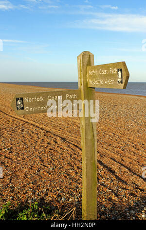 A Norfolk Coast Path sign on the shingle ridge at Cley next the Sea, Norfolk, England, United Kingdom. - Stock Photo