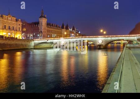 Conciergerie at night, Paris, France - Stock Photo