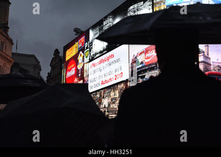 Piccadilly Circus, London, UK. 16th Jan, 2017. The iconic advertising lights at Piccadilly Circus are switched off. - Stock Photo