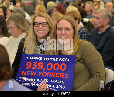 New York, USA. 15th Jan, 2017.  Two sister hold sign 'Thanks to the ACA 939,000 NEW YORKERS have gained health Insurance - Stock Photo
