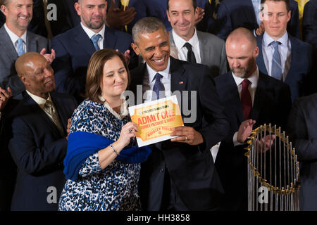 Washington, USA. 16th January, 2017. US President Barack Obama (Front R) is presented a pass to Wrigley Field by - Stock Photo