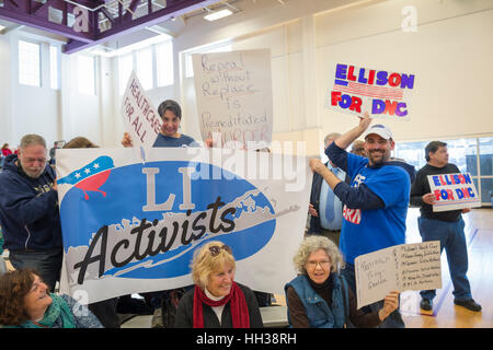 Westbury, USA. January 15, 2017.  LI Activists group members bring a large banner and signs to the 'Our First Stand' - Stock Photo