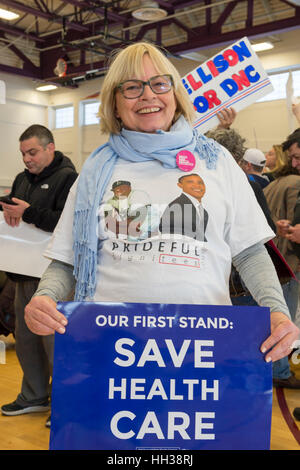 Westbury, USA. January 15, 2017.  Nancy Berger, of Merrick, is holding an 'Our First Stand: Save Health Care' poster - Stock Photo