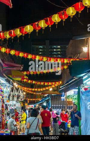 SINGAPORE - APRIL 6: Tourists walking along Singapore china town at night market in April 2016 - Stock Photo
