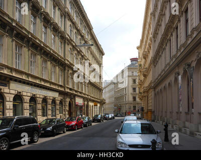 VIENNA, AUSTRIA - AUGUST 3, 2014: a side street view with parked cars and Baroque buildings in central Vienna near - Stock Photo