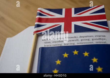 Brexit Concept: British and EU flags on a dictionary page emphasizing the word Exit - Stock Photo
