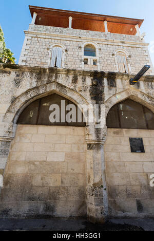 A mark of station 3 of the Via Dolorosa, and an Armenian church, old city of Jerusalem, Israel, Middle east - Stock Photo