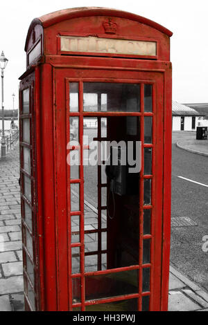 British telephone box vandalized.  Edited using selective color - Stock Photo