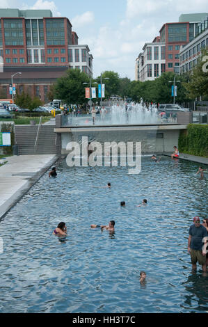 People are splashing in pool at Yards Park, a scenic park with a riverfront boardwalk in the summer in Washington, - Stock Photo