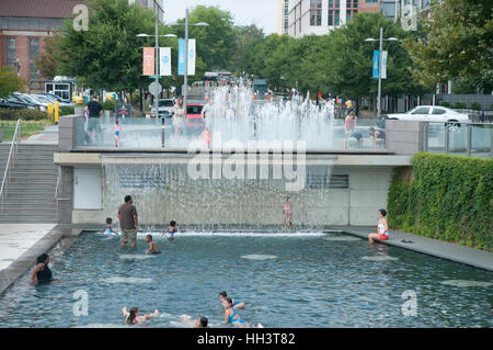 People are splashing in pool at Yards Park in the summer in Washington, DC - Stock Photo