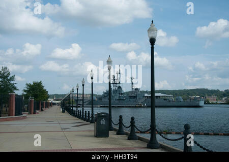 Navy ship is anchored at the end of a lighted walkway at the Anacostia River Navy Yard in Washington, DC - Stock Photo
