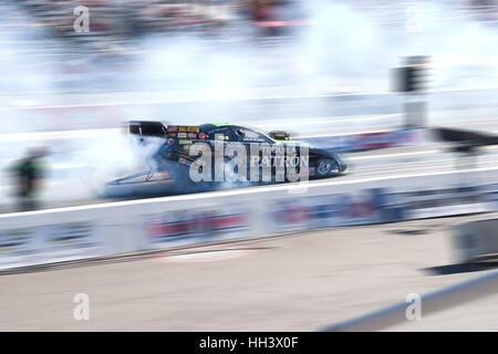 Alexis Dejoria's Tequila Patron funny car at the Auto Club Raceway in Pomona NHRA Winternationals doing a burnout - Stock Photo
