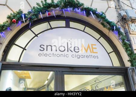 Sign above smoke me e-cigarette shop in Rome, Italy - Stock Photo