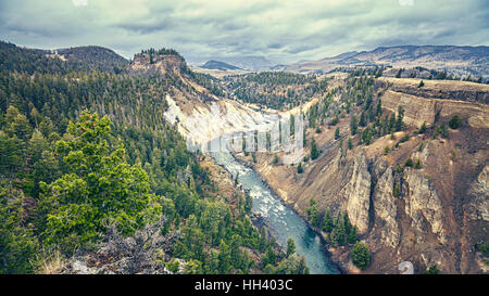 Color toned canyon in Yellowstone National Park on rainy day, Wyoming, USA. - Stock Photo
