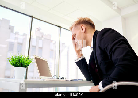 The concept stress, problems in business. Blond businesswoman ho - Stock Photo