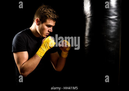Woman punching bag in gym · Attractive young man in yellow boxing wraps is  training and hitting heavy bag. Fitness, c7a21d8fe6