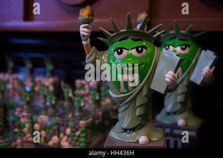 M&M's green character as Statue of Liberty candy dispenser displayed at M&M's world in Times Square, Manhattan, - Stock Photo