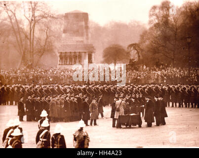 King George VI decorates and hands out medals to the crew of HMS Exeter, Ajax and Achilles on Horse Guards Parade. Stock Photo
