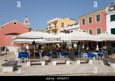 Cafes and restaurants in main square of Gaios town, Paxos, Ionian Islands, Greek Islands, Greece, Europe - Stock Photo