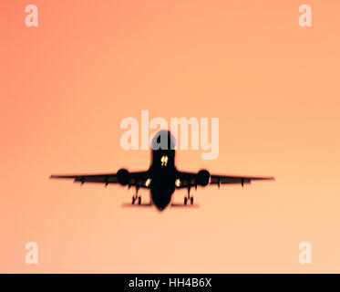 Commercial airliner on final approach to runway, London, England, UK - Stock Photo