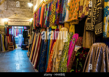 Traditional dresses for sale at the Souq Waqif market in Doha, Qatar - Stock Photo