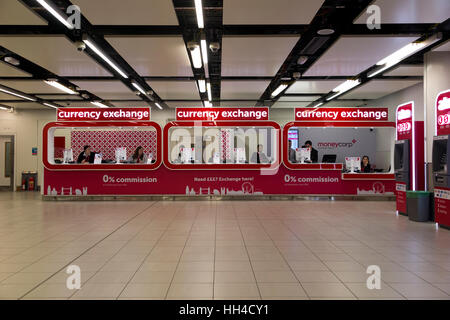 A traveller changing money at the bureau de change north terminal stock photo 36968916 alamy - Gatwick airport bureau de change ...