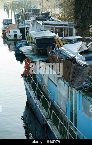 Popularly described as a ' slum ' boat, house boats are pictured moored at Teddington Lock, on the River Thames. - Stock Photo