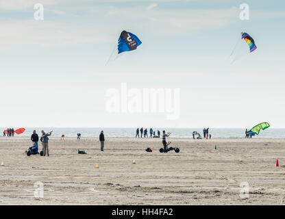 OUDDORP,NETHERLANDS - MARCH 07 2015:Unidentified man kite surfing on the beach in Ouddorp on March 07 2015, ouddorp - Stock Photo