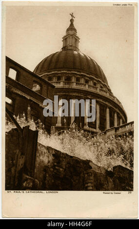 Bomb damage in London - looking up from the rubble to St Paul's Cathedral Dome, which remained miraculously intact. - Stock Photo
