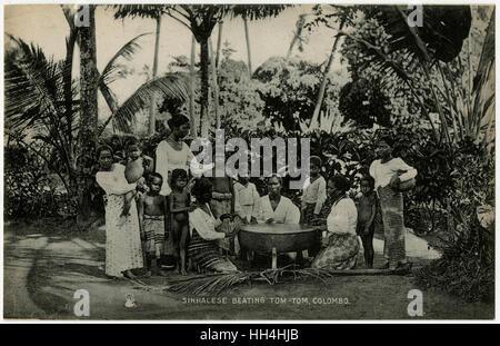 Playing the Rabana drum - Sinhalese people - Colombo, Sri Lanka. The Maha (big) Rabana or Banku (bench) Rabana, - Stock Photo