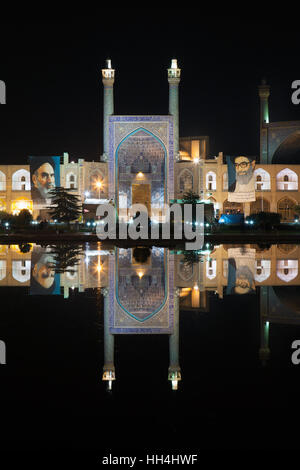 Imam mosque ( also known as Shah mosque ) reflected in a pool by night, Isfahan, Iran - Stock Photo