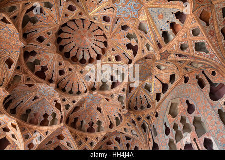Patterned ceiling with shapes of music instruments in Ali Qapu Palace, Esfahan, Iran - Stock Photo