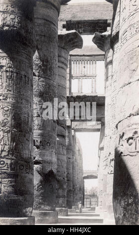 Columns in the Great Hypostyle Hall at Karnak, Egypt. The hall is part of the Precinct of Amun-Re, the largest of - Stock Photo
