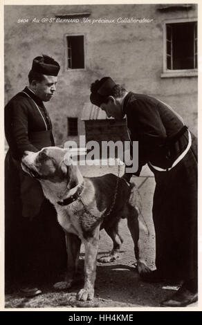 A St. Bernard Dog with two priests - Switzerland. The earliest written records of the St. Bernard breed are from - Stock Photo