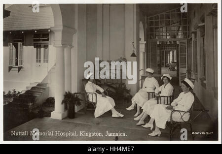 Nuttall Memorial Hospital, Kingston, Jamaica, West Indies, with four nurses seated on a terrace. - Stock Photo