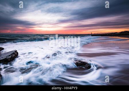 Long exposure capture of Bournemouth Beach at sunset - Stock Photo